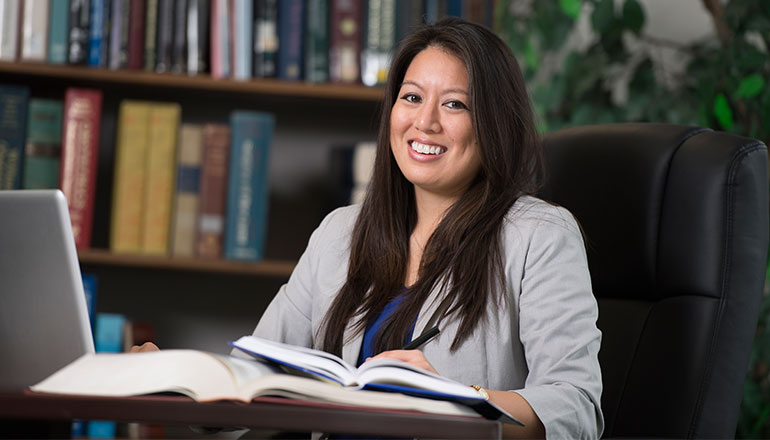 Graduate student studying for Health Law program